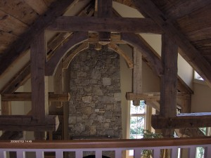 Beautiful, hand made antique trusses in the Great Room are a great example of the incredible details in this home!